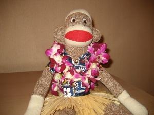 "Steve kicks back at a luau and sips some ""pineapple juice."""