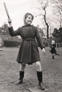 Okay, so in rounders you swing a bat at a ball and score by successfully running around four bases. But she's clearly holding the bat in one hand. It's completely different. See?  photo credit: theirhistory via photopin cc
