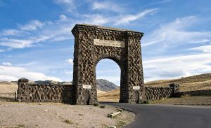 We entered the Yellowstone through the North Gate, called the Roosevelt Arch and dedicated by President Theodore Roosevelt on his 1903 visit. By Acroterion (Own work) [CC-BY-SA-3.0 (http://creativecommons.org/licenses/by-sa/3.0)], via Wikimedia Commons
