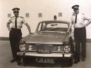 These men look like they've had a long day. I bet they could use a pizza.   photo credit: Ross & sutherland Constabulary patrol car 1968 via photopin (license)