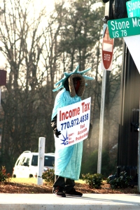 The Statue of LIbertry wearing a fur-lined hood is creepy enough. In my town where it's been warm the last few days, one Mr. Liberty has been wearing shorts under his robe. I hope.  photo credit: Income tax of liberty via photopin (license)